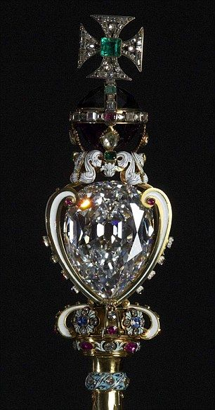 The Sovereign's Sceptre containing the largest flawless cut diamond in the world. It is part of the biggest diamond ever found. The great Cullinane found at over 3,000carats. Elizabeth' mother wore the Kohinoor at her coronation.