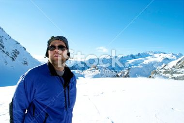 Man on top of the Mt Cook Ranges, New Zealand Royalty Free Stock Photo
