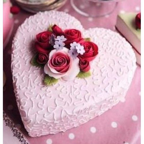 Heart shape cake with flowers decortation on top. You can send customized cake by choosing flavour of your choise and writing romantice message on it.  Total weight of cake: 1 KG  It may take, 3-4 hour for its prepration and delivery across Jaipur. It can also be delivered same day in other cities of Rajasthan. Kindly place the order accordingly.