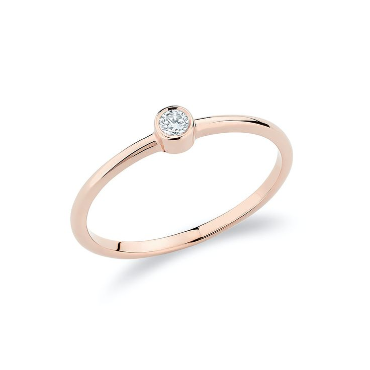 Stacking solitaire ring with one diamond set in 18K rose gold.