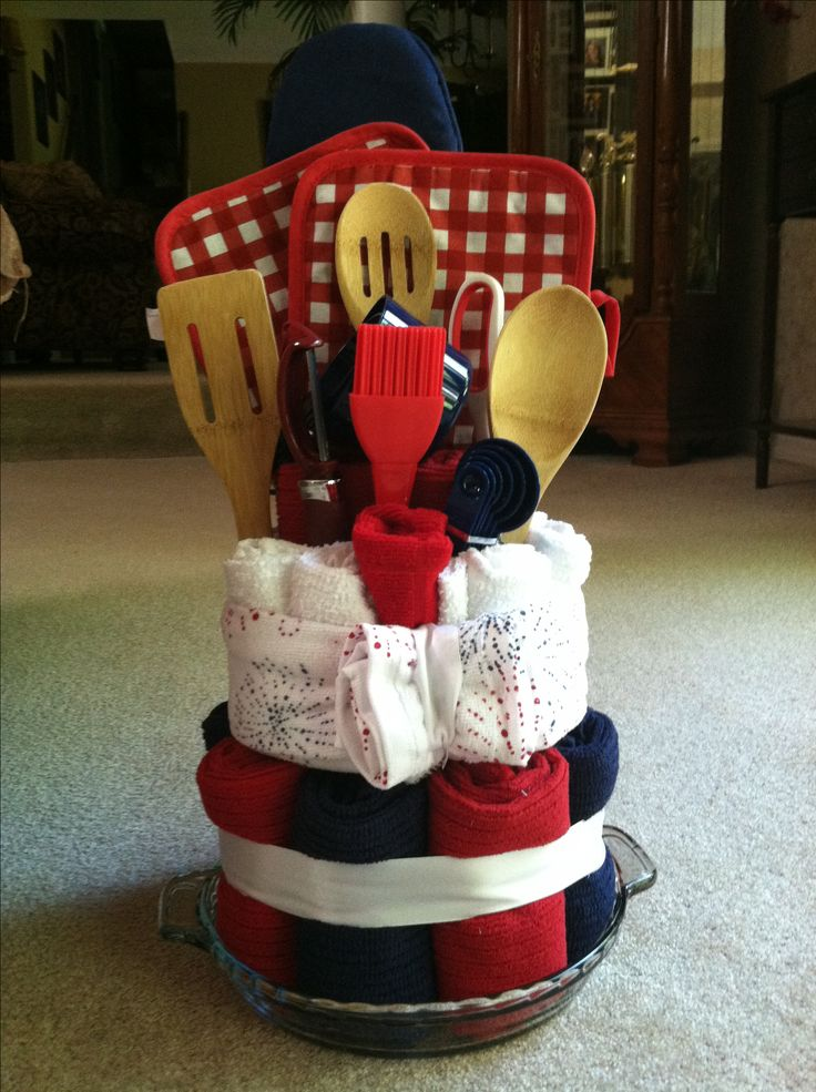 Bridal shower kitchen necessities cake! I need wooden spoons/ plastic cooking utensils nice oven mits or dish cloths kitchen is Tuscany done in wine with yellow and rusty red  and green decor
