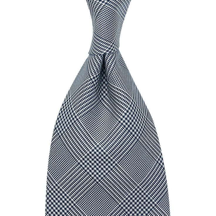 Handmade in Italy Fabric: 100% silk Length: 147cm (= 58 inch) Construction: 3-fold self tipped This model here is the perfect iteration of a classic wedding tie. White and navy silk woven in a beautiful glencheck...