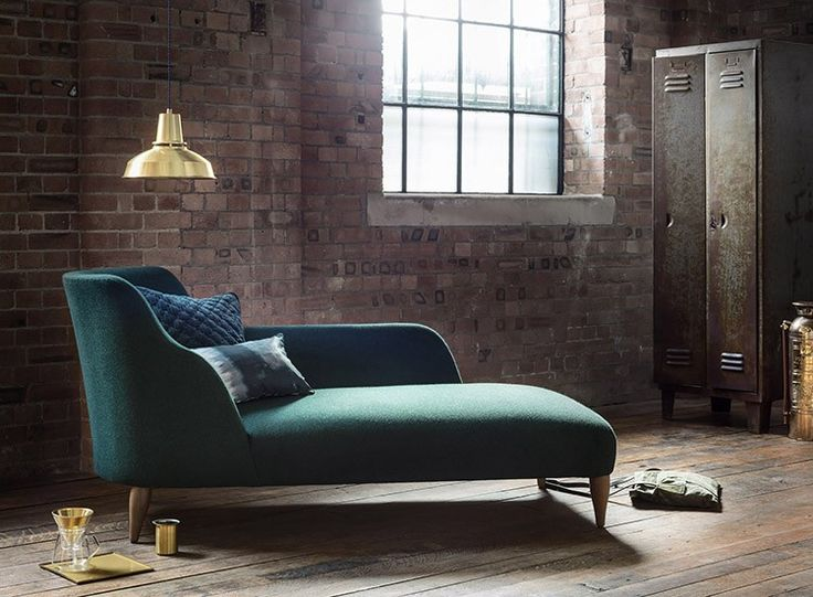 Forest Green upholstery proves a smart contrast to raw brick and timber