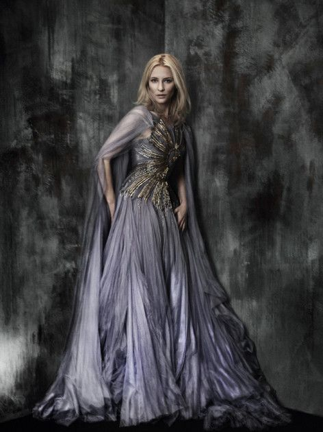 I wish I knew who this was, and who made the gorgeous dress. (For some reason I'm thinking Cate Blanchett, by the cheekbones perhaps?) She could actually be Myrenne. EXACTLY the right pose and emotion.
