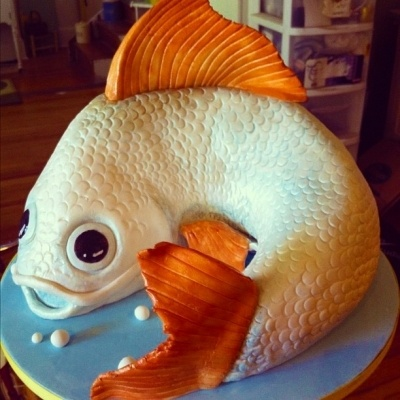 Somehow I am both weirded out and impressed by the Goldfish Cake, by Bythebullseye on CakeCentral.com