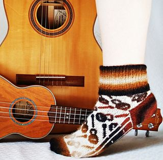 "A funky colorwork sock for all guitarists, ukulele players, and music lovers – whether you strum or just hum along, these socks are ""instrumental""!"