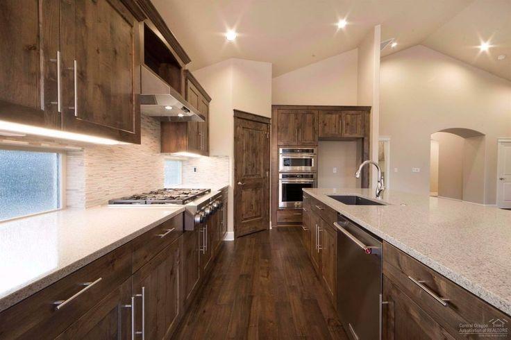 Pahlisch Homes Kitchen With Knotty Alder Cabinetry Quartz