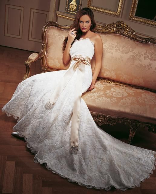Santa Monica  Strapless corded lace bridal gown with fluted fishtail skirt, satin ribbon sash with lace detail.