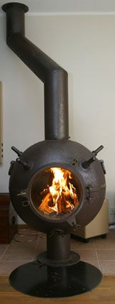 Mine Fireplace turning old Russian mines into functional furniture!! Now THAT'S what I call re-purposing!