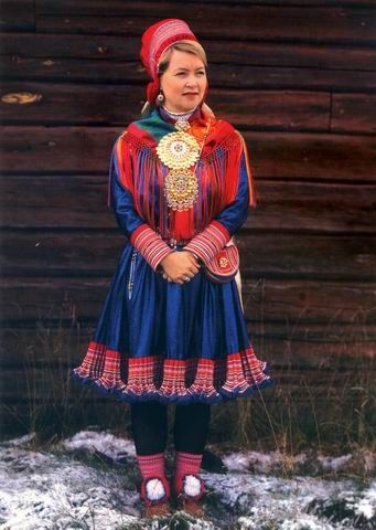 Europe | Portrait of a Saami woman wearing traditional clothing, Finland