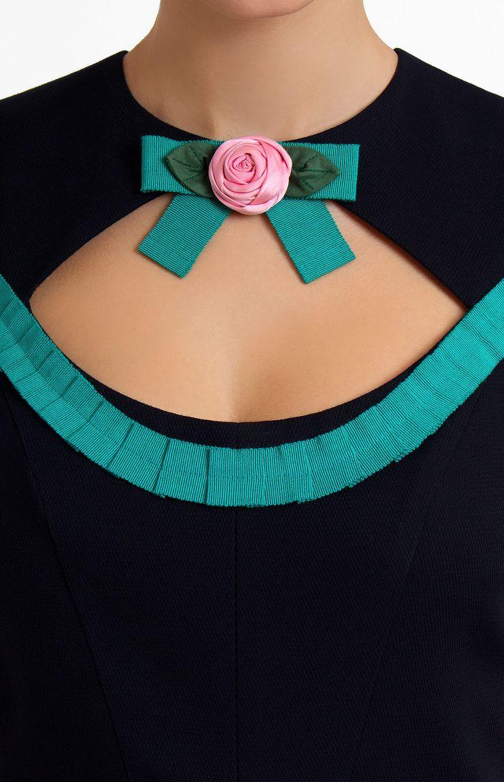 Short-sleeve slinky stretchy cotton dress decorated with ribbon. Round neck. Low neckline. Designer handmade cotton ribbon flower. Hidden back zip closure. Drapery hip side pockets.