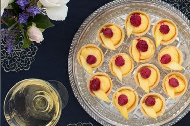 Lime curd tartlets with mango and raspberries
