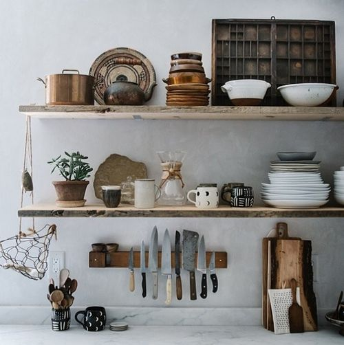 Love the knives on the magnetic strip and the open wood shelves.