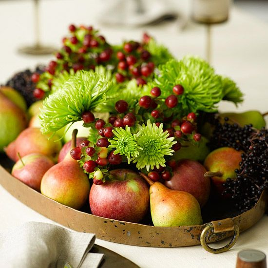 Combine fall fruits and flowers for a seasonal centerpiece. Plus, get 30 more ways to decorate for fall with seasonal elements.