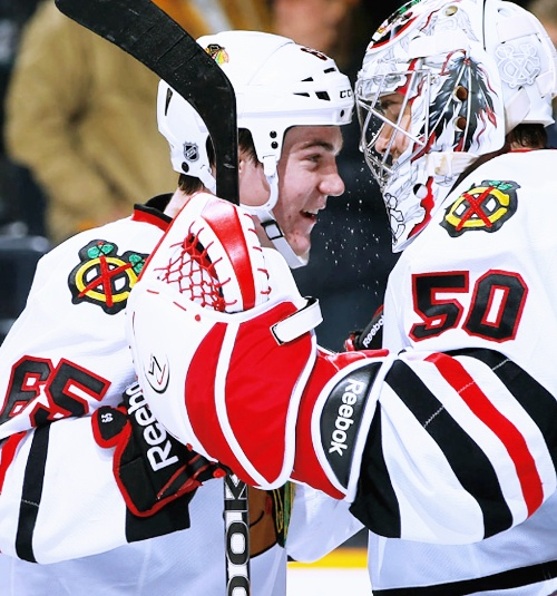 Andrew Shaw and Corey Crawford