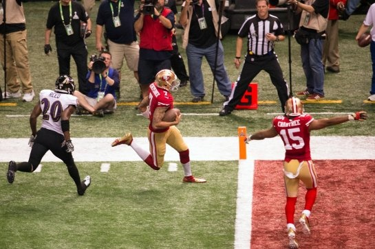 San Francisco 49ers quarterback Colin Kaepernick scores on a 15-yard touchdown run during the fourth quarter of Super Bowl XLVII against the Baltimore Ravens at the Mercedes-Benz Superdome on Sunday, Feb. 3, 2013, in New Orleans.