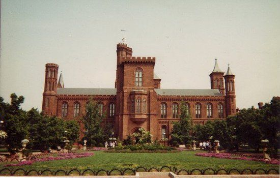 Smithsonian Institution Building The red sandstone Smithsonian institution building, with its light crenellated towers, symbolizes the entire institution to many visitors. Popularity known as the castle, this building housed all the Smithsonian's operations when it opened in 1855. Today, it houses the Smithsonian information center.