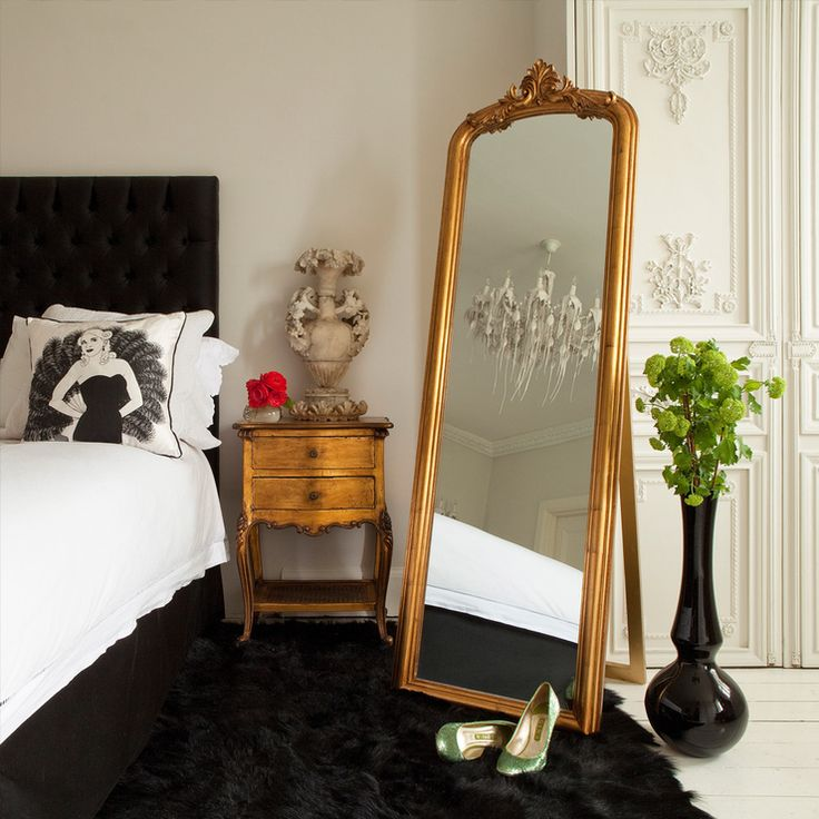 Hanging a single big mirror or an array of small mirrors on the walls will make your room appear much bigger. If possible, place a mirror opposite to the doorway. Reflective surfaces of furniture is also an effective way to enhance your room.