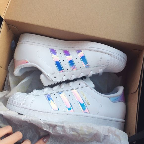 NEW Adidas Holographic Superstar 100% authentic, brand new in box  Only size 7 left (8.5 in women) *Please do not purchase this listing. Lmk if you want to purchase so I can make a listing for you. Thank you! :) Hurry! These are selling out quick! ❤️  DISCOUNT: $100 on Ⓜ️ercari Adidas Shoes Sneakers