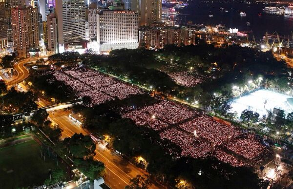 Tens of thousands of people attend a candlelight vigil at Victoria Park in Hong Kong, Thursday, June 4, 2015. Hong Kongers held a candlelight vigil Thursday night to mark the suppression of the 1989 student-led Tiananmen Square protests, an annual event that takes on greater meaning for the city's young after last autumn's pro-democracy demonstrations sharpened their sense of unease with Beijing. Credit: AP Photo/Kin Cheung