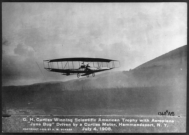 """Glenn Curtiss flying the """"June Bug"""" on July 4, 1908 (Photo courtesy Library of Congress). This was the first long-distance city-to-city flight between Albany, NY and New York City."""