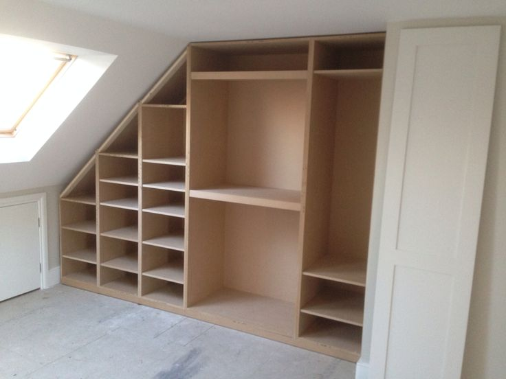 Loft room conversion. Wardrobe to fit sloping ceiling. Interior layout.