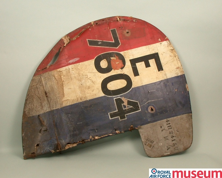 British aircraft rudder.    This rudder is from Sopwith Snipe E7604, built by the Ruston & Proctor Company on 20 March 1918 under contract 35a/433/c301. In conjunction with the ailerons (moveable flaps on the wings) and elevators (moveable flaps located on the tailplane), the rudder helps to steer the aircraft.