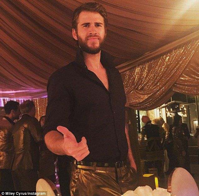 'My dude is HOT': Miley Cyrus admired her fiancé Liam Hemsworth (pictured) as they attended a New Year's Eve party with his brother Chris and wife Elsa Pataky
