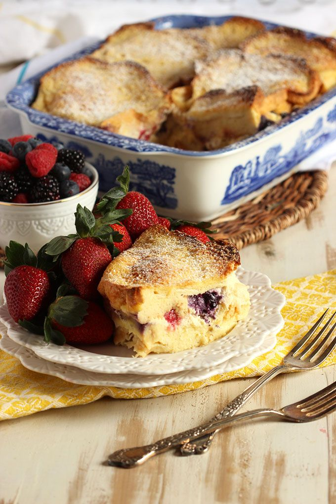 The BEST Stuffed French Toast Casserole recipe ever! Buttery brioche, fresh berries and cream cheese baked in a creamy custard. Perfection! | @suburbansoapbox #ad #IDSimplyPure