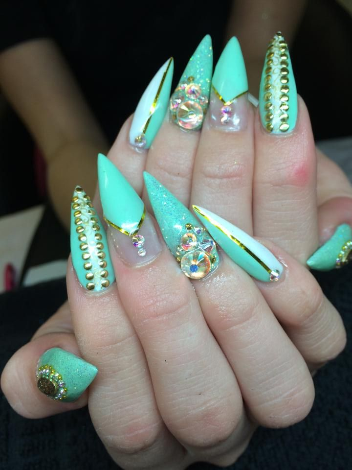 Aqua and gold with gem embellishments make for an eye-catching take on the negative space manicure, by Amanda Trivett. #nails #nailart