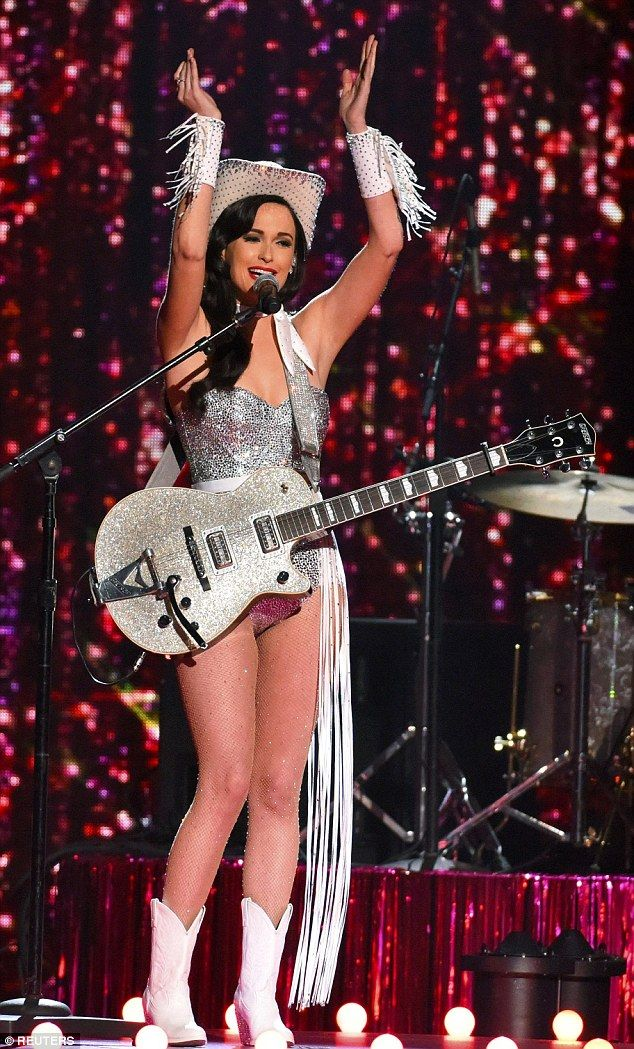 Kacey Musgraves dons custom leotard, gloves, hat and guitar dazzling with crystals from Swarovski for the 2015 CMAs