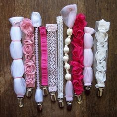 pacifier clips. cute diy baby shower gift! by iris. I make paci clips all the time from grosgrain ribbon or crochet. why did I not think off this?