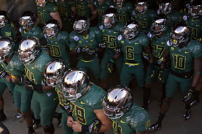 The Ducks take the field for the 2012 Rose Bowl donning their shiny silver helmets.