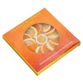 A display box of Orange and Lemon fruit flavour slices. These are a traditional favourite over the festive period. The fine fruit flavour jelly slices are decoratively arranged in a tray around the centre sweet. Ideal for those individuals with a sweet tooth but even better for sharing.