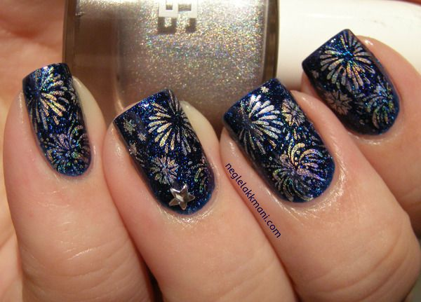 Holographic Fireworks nail art over a navy background #celebrations...x