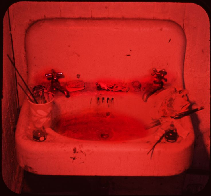 """This works consists of 80 projected slides and one mounted still photo of a cluttered artist's sink. Michael Snow, """"Sink,"""" 1970, Museum of Modern Art."""