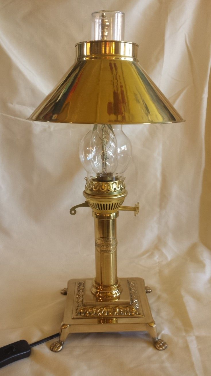 Orient Express Recreated. This is very special. A late 1960's brass reproduction Orient Express lamp in mint condition, still with original globe though the switch has been replaced. Fifty-two cms high.