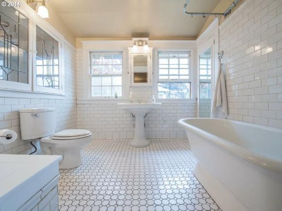 Love the white-on-white tile in this Craftsman bathroom!  Grey grout on the floor...smart!!  {1910 N WINCHELL ST, Portland, OR, 97217 - MLS# 14598769 - Estately}