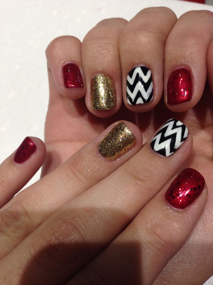Shellac nails with chevron design , red glitter, gold glitter!!!Makeup
