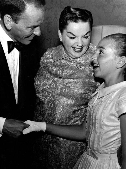 Mobster/slave handler Frank Sinatra, Judy Garland, & Liza Minnelli.  Young Liza would soon regret ever having met violent and sadistic Frank Sinatra.