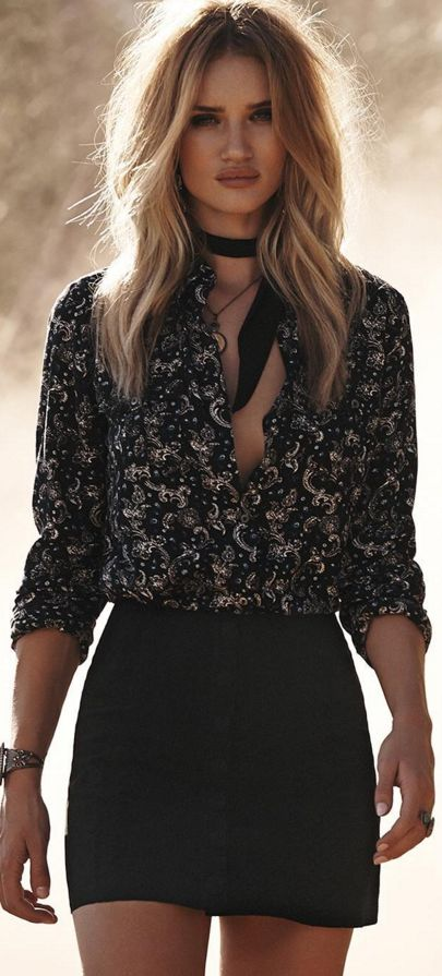 Who made  Rosie Huntington-Whiteley's black skirt and print long sleeve top?