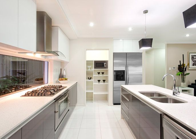 Elara | Designs | Ausbuild Kitchen - upper cupboards and inside island bench are a light woodgrain finish