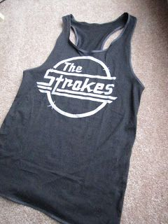 Cut my The Strokes t shirt into a racer back, using another racer back as a stencil of sorts, then hem it. Perfect!