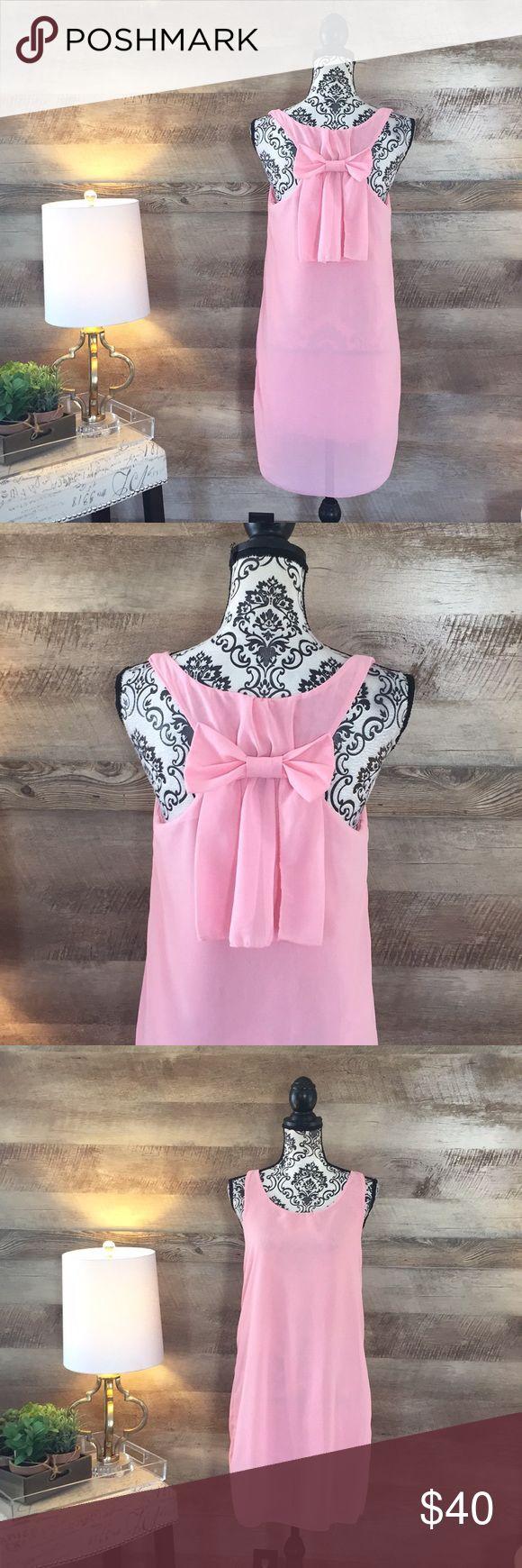 Sweet Bow Back Classic Sheath Dress Size medium. Pink. Bow Back design. Lined. Sleeveless. Dresses Mini