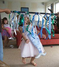 Game idea: Add crepe paper and ribbon to a stick to create mermaid limbo