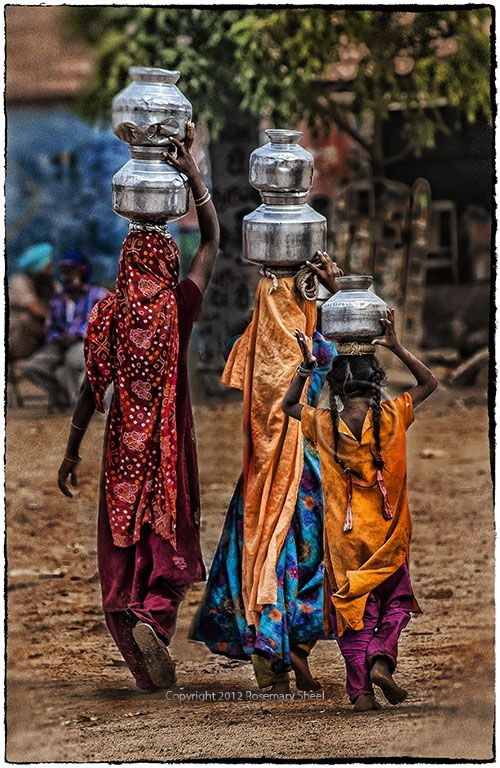 Girls fetching water in jugs from Gujarat, India (Photo: Rosemary Sheel)
