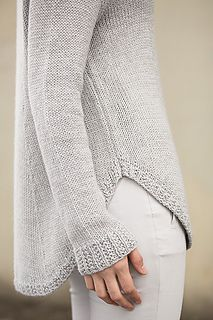 This loose-fitted knit sweater would make a lovely sailing outfit