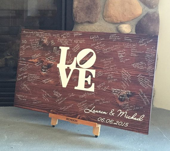 Philadelphia wedding guest book option: Love Sculpture graphic on a wooden sign | HomeSignDesigns, Etsy