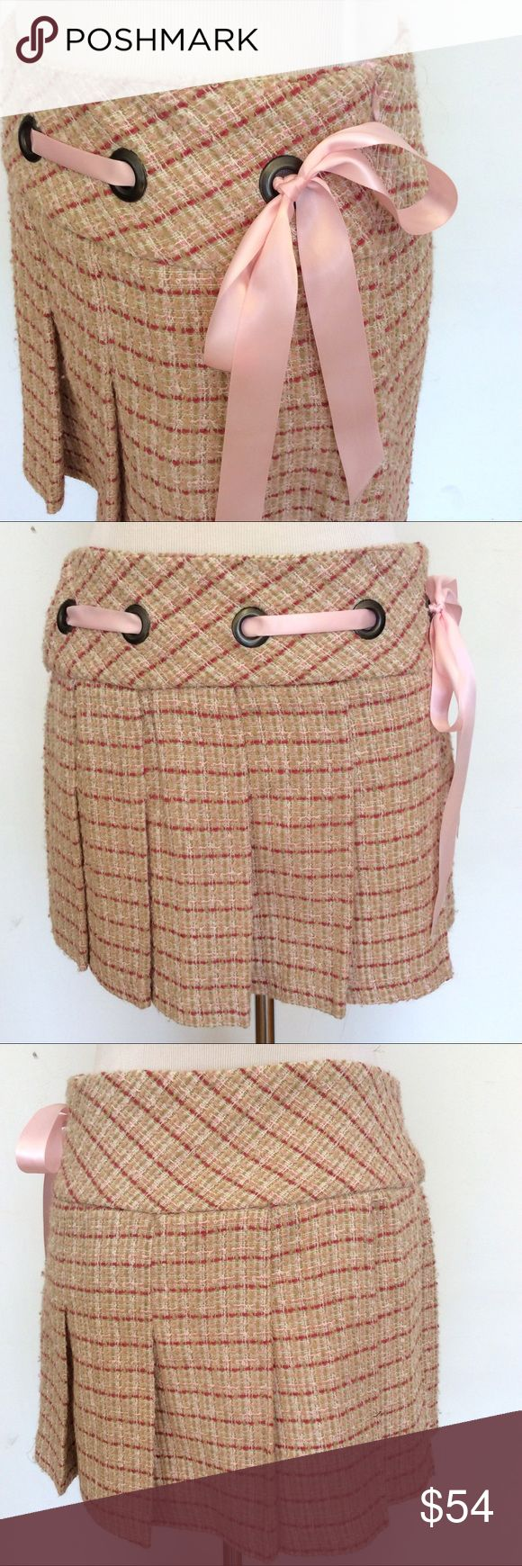 "Guess Jeans Pink Tweed Pleated Bow Punk Skirt XS Guess Pink Green Tweed Plaid Pleated Mini Knee Skirt Bow Cosplay Anime XSmall  Soooo cute! Light pink/beige/green tweed patterned pleated skirt with ribbon lacing through the top. Side zipper.   Heavier fabric and great for colder weather! A fun and flirty skirt that could also work well with anime & cosplay costumes. :)   Barely worn and in excellent condition!  Size: Extra Small Waist/Hips (flat): 14.5"" Length: 13""  100% Acrylic.  Please…"