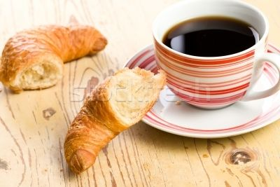 breaking croissant with coffee stock photo © Jiri Hera (jirkaejc ...